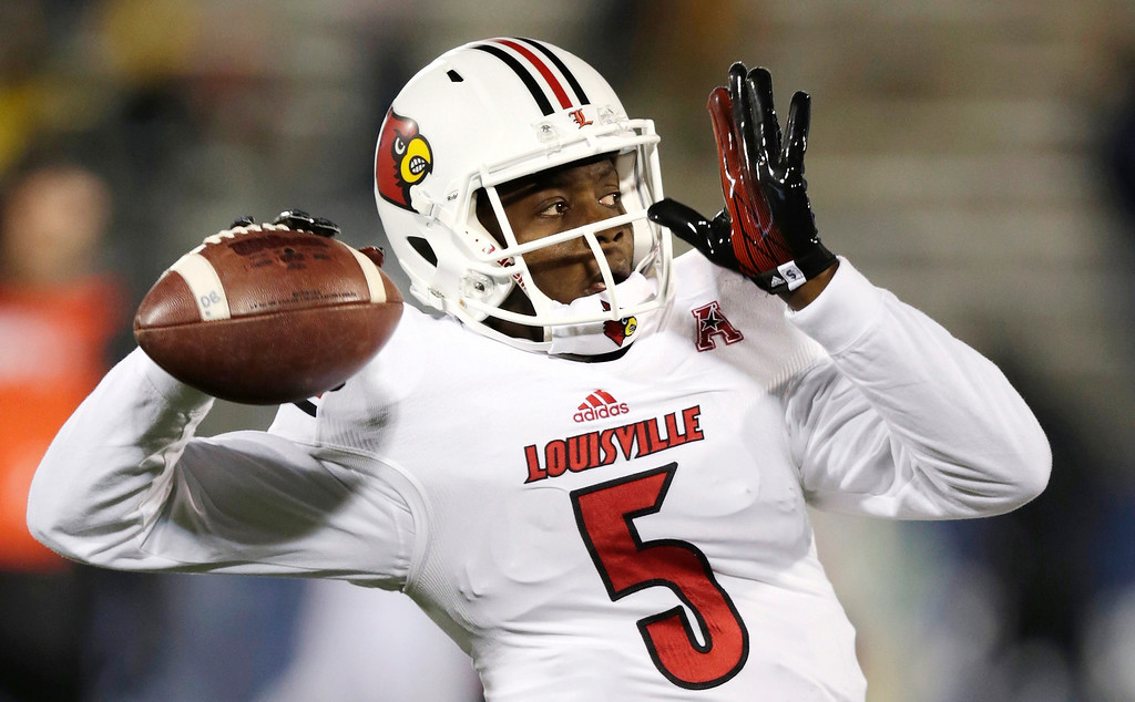 . In this Nov. 8, 2013, file photo, Louisville quarterback Teddy Bridgewater warms up for an NCAA college football game against Connecticut, in East Hartford, Conn. Bridgewater was selected in the first round, 32nd overall, by the Minnesota Vikings in the NFL draft on Thursday, May 8, 2014. (AP Photo/Charles Krupa, File)