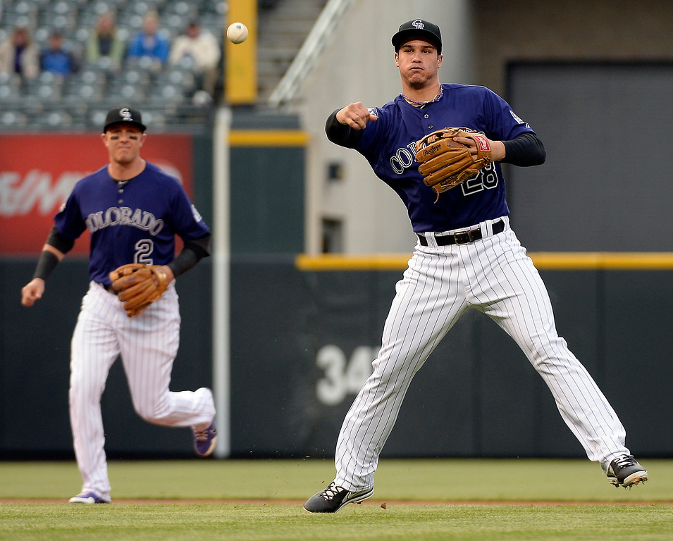 . DENVER, CO. - MAY 20: Nolan Arenado (28) of the Colorado Rockies throws out Didi Gregorius (1) of the Arizona Diamondbacks at first base in the first inning May 20, 2013 at Coors Field. (Photo By John Leyba/The Denver Post)