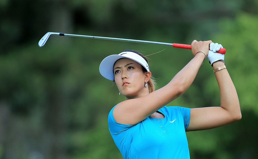 . Michelle Wie of the USA follows her tee shot at the par 3, 15th hole during the final round of the 69th U.S. Women\'s Open at Pinehurst Resort & Country Club, Course No. 2, on June 22, 2014 in Pinehurst, North Carolina.  (Photo by David Cannon/Getty Images)