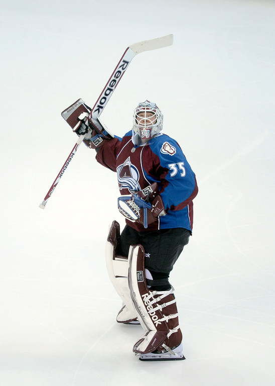 . DENVER, CO. - JANUARY 21:  Avalanche goaltender Jean-Sebastien Giguere snuck a peak at the scoreboard as he skate towards the net in the second period. He replaced Varlamov after the game\'s third goal. The Colorado Avalanche hosted the Toronto Maple Leafs Tuesday night, January 21, 2014 at the Pepsi Center. Photo By Karl Gehring/The Denver Post