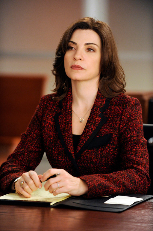 ". This image released by CBS shows Julianna Margulies in a scene from ""The Good Wife.\""  Margulies was nominated Thursday, Dec. 13, 2012 for a Golden Globe for best actress in a drama series for her role in the show.  The 70th annual Golden Globe Awards will be held on Jan. 13.(AP Photo/CBS, Jeffrey Neira)"