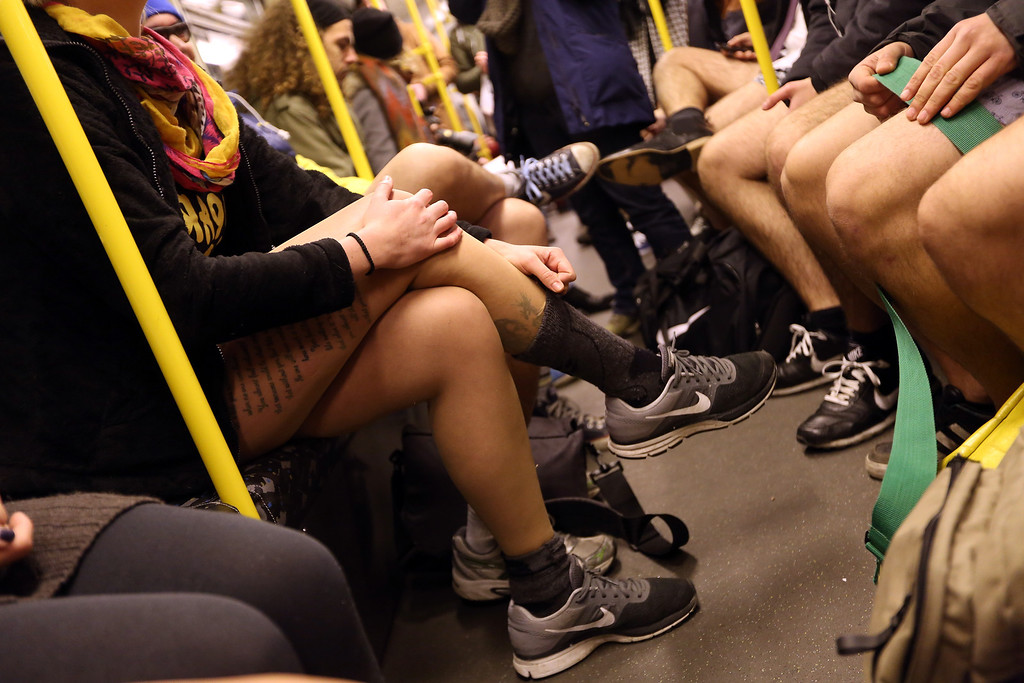 . Participants of the No Pants Subway Ride ride a train on January 12, 2014 in Berlin, Germany. The annual event, in which participants board a subway car in January while not wearing any pants while behaving as though they do not know each other, began as a joke by the public prank group Improv Everywhere in New York City and has since spread around the world, with enthusiasts in around 60 cities and 29 countries across the globe, according to the organization\'s site.  (Photo by Adam Berry/Getty Images)