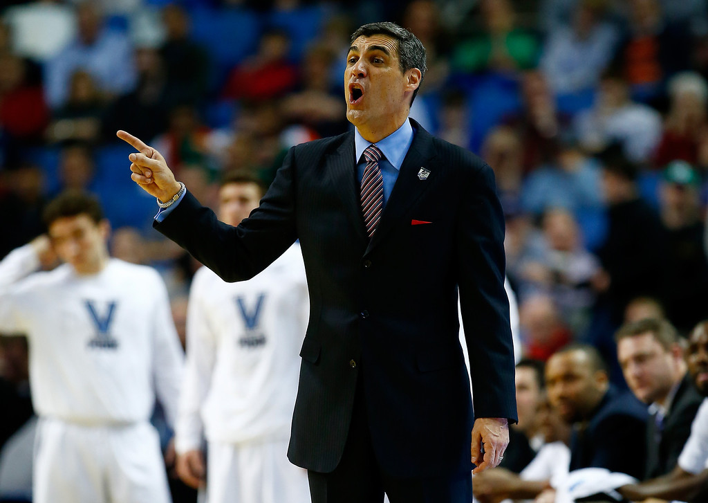 . BUFFALO, NY - MARCH 22:  Head coach Jay Wright of the Villanova Wildcats motions to his players during the third round of the 2014 NCAA Men\'s Basketball Tournament against the Connecticut Huskies at the First Niagara Center on March 22, 2014 in Buffalo, New York.  (Photo by Jared Wickerham/Getty Images)