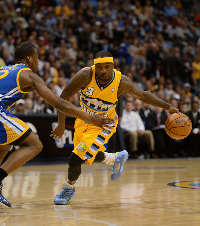 . DENVER, CO. - APRIL 23: Denver Nuggets point guard Ty Lawson (3) drives to the basket in the first quarter. The Denver Nuggets took on the Golden State Warriors in Game 2 of the Western Conference First Round Series at the Pepsi Center in Denver, Colo. on April 23, 2013. (Photo by John Leyba/The Denver Post)