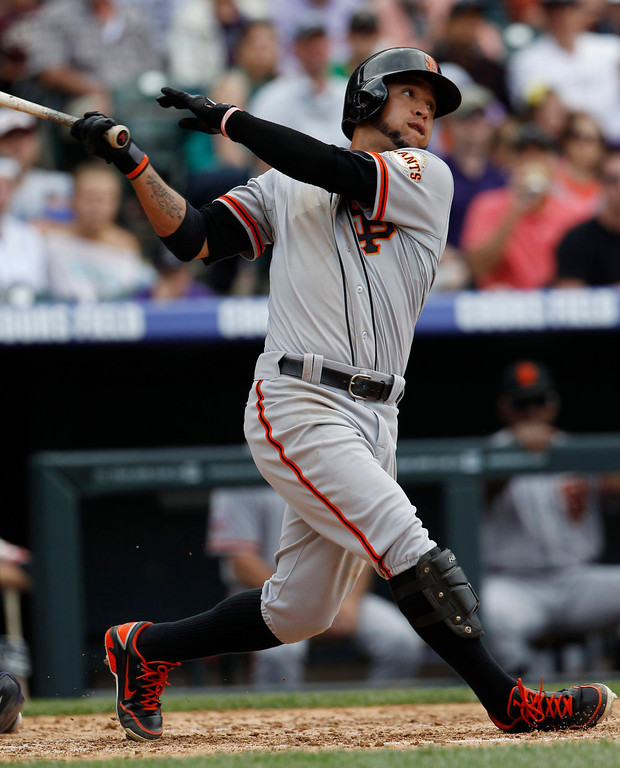 . San Francisco Giants\' Gregor Blanco singles against the Colorado Rockies in the fifth inning of a baseball game in Denver on Sunday, May 19, 2013. (AP Photo/David Zalubowski)