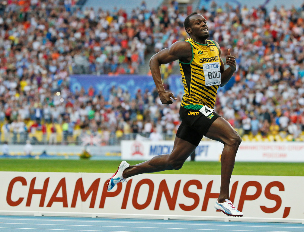 . Jamaica\'s Usain Bolt competes to win the men\'s 200-meter final at the World Athletics Championships in the Luzhniki stadium in Moscow, Russia, Saturday, Aug. 17, 2013. (AP Photo/Alexander Zemlianichenko)