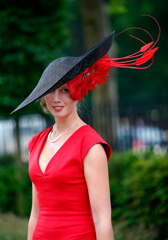 . Racegoer Louise Black arrives for Ladies\' Day at the Royal Ascot horse racing festival at Ascot, southern England June 20, 2013.  REUTERS/Darren Staples