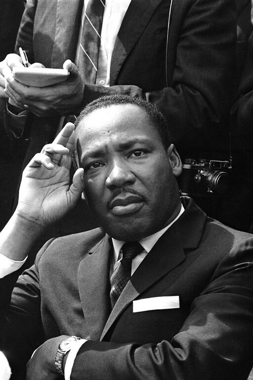 . In this Sept. 16, 1963 file photo, Dr. Martin Luther King Jr. gives a news conference in Birmingham, Ala. announcing he and other African American leaders have called for federal Army occupation of Birmingham in the wake of the previous day\'s church bombing and shootings which left six blacks dead. (AP Photo)