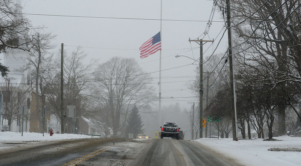 . A flag is flown at half-mast to mark the one-year anniversary of Sandy Hook Elementary School shooting in Newtown, Connecticut, on December 14, 2013. Adam Lanza, 20, shot and killed 20 students and 6 teachers before shooting himself on December 14, 2012.  TOPSHOTS/AFP PHOTO/Emmanuel DUNAND/AFP/Getty Images