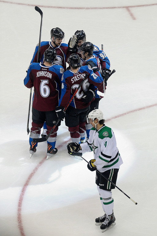 . Colorado Avalanche left wing Gabriel Landeskog (92) celebrates his goal with teammates as Dallas Stars defenseman Brenden Dillon (4) skates by during the second period. (Photo by AAron Ontiveroz/The Denver Post)