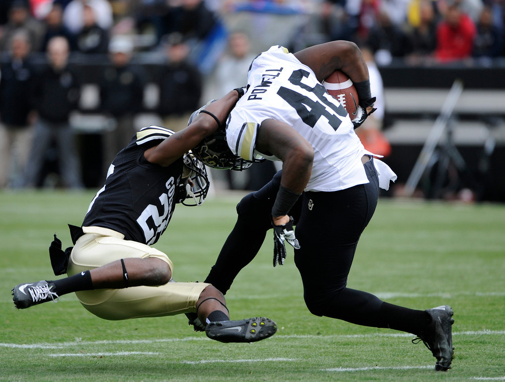 . BOULDER, CO.- APRIL13: John Walker, left, takes down Christian Powell as he moves downfieldThe University of Colorado football team hosts its spring football game at Folsom Field under the direction of new head coach Mike MacIntyre. (Photo By Kathryn Scott Osler/The Denver Post)