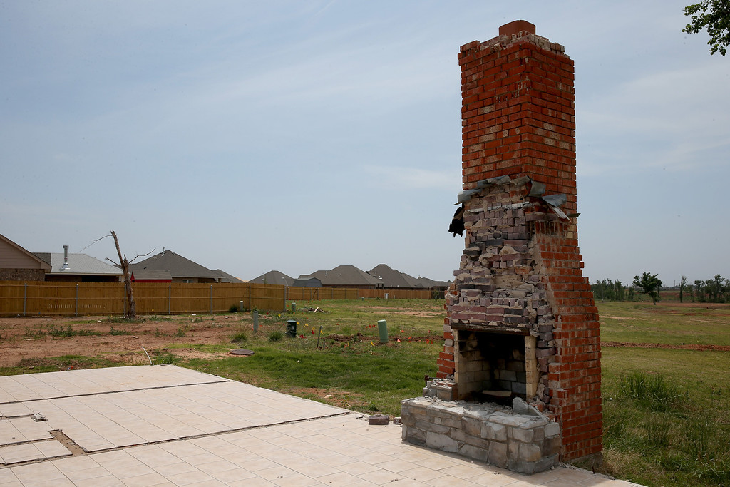 . A fireplace is seen where a house once stood as preparations are under way  for Tuesday\'s one-year anniversary of the town being devastated by a tornado on May 18, 2014 in Moore, Oklahoma.  On May 20, 2013, a two-mile wide EF5 tornado touched down in the town, killing 24 people and leaving behind extensive damage to homes and businesses.  (Photo by Joe Raedle/Getty Images)