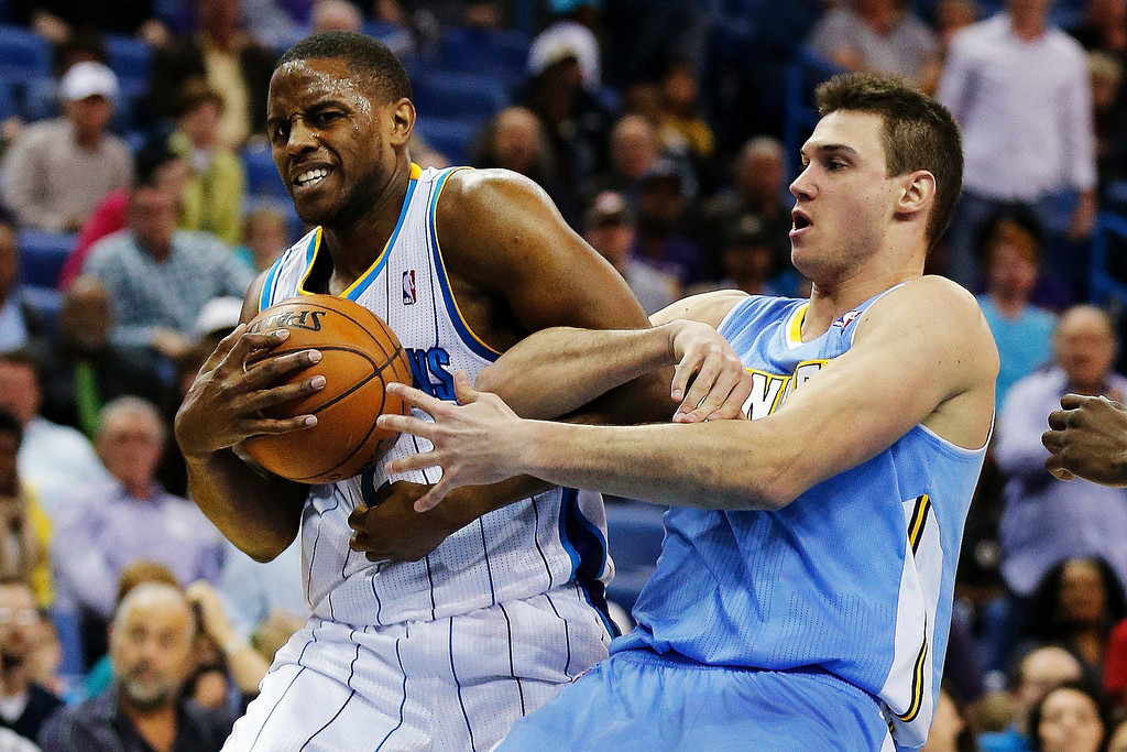 . New Orleans Hornets forward Darius Miller, left, and Denver Nuggets forward Danilo Gallinari (8) battle for a rebound in the second half of an NBA basketball game in New Orleans, Monday, March 25, 2013. The Hornets won 110-86. (AP Photo/Bill Haber)