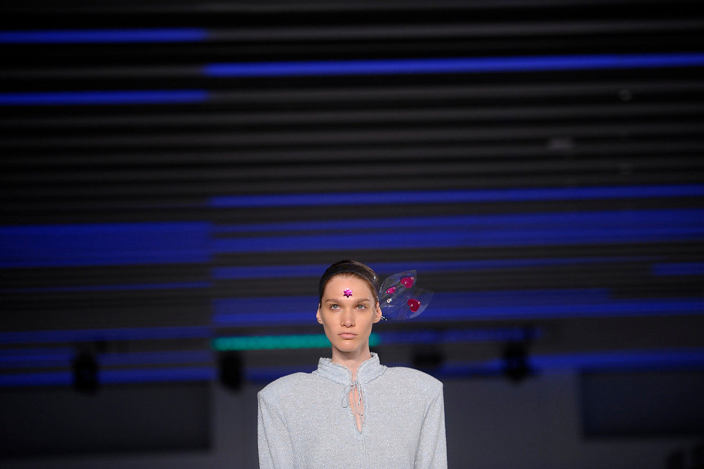 . A models wears a creation from Naulover during a 080 Barcelona fashion show in Barcelona, Spain, Friday, July 12, 2013.  (AP Photo/Manu Fernandez)