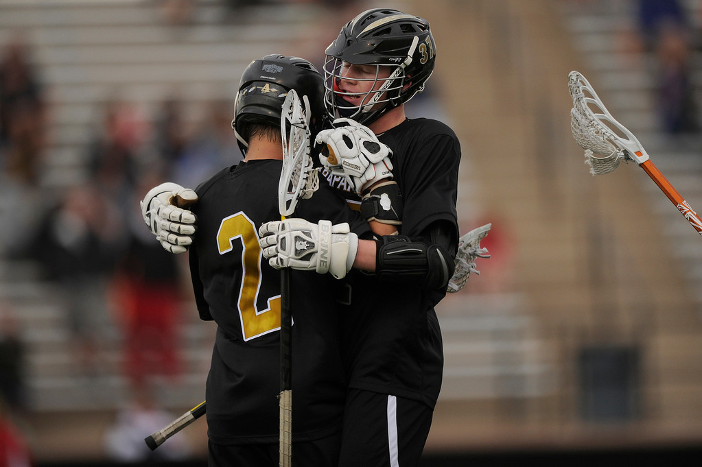 . DENVER, CO - MAY 15: Arapahoe High School senior midfielder Michael Babb #2 celebrates after a goal with junior attacker Brendan Till #37 during a CHSAA 5A boys lacrosse semifinal game on May 15, 2013, in Denver, Colorado. Arapahoe won 13-5 to advance to the finals. (Photo by Daniel Petty/The Denver Post)