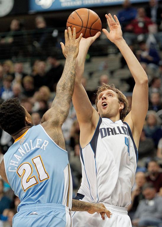 . Dallas Mavericks forward Dirk Nowitzki (41) shoots as Denver Nuggets\' Wilson Chandler (21) defends during the second half of an NBA basketball game Monday, Nov. 25, 2013, in Dallas. Denver won 110-96. (AP Photo/Brandon Wade)