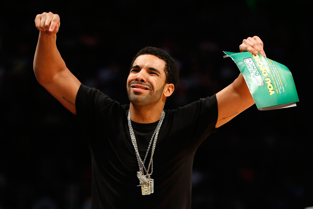 . HOUSTON, TX - FEBRUARY 16:  Rapper Drake reacts during the Sprite Slam Dunk Contest part of 2013 NBA All-Star Weekend at the Toyota Center on February 16, 2013 in Houston, Texas.   (Photo by Scott Halleran/Getty Images)