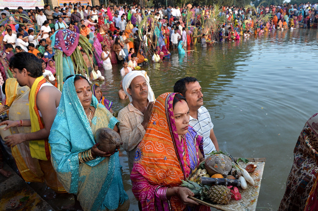 . Hindu devotees pray to the Sun God as part of the Chhath puja at a lake in Bangalore on November 8, 2013.  AFP PHOTO/Manjunath Kiran/AFP/Getty Images