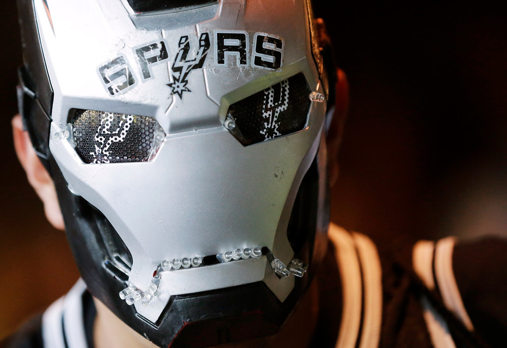 . San Antonio Spurs fan Juan Ramirez arrives before Game 5 of the NBA basketball finals against the Miami Heat on Sunday, June 15, 2014, in San Antonio. (AP Photo/David J. Phillip)