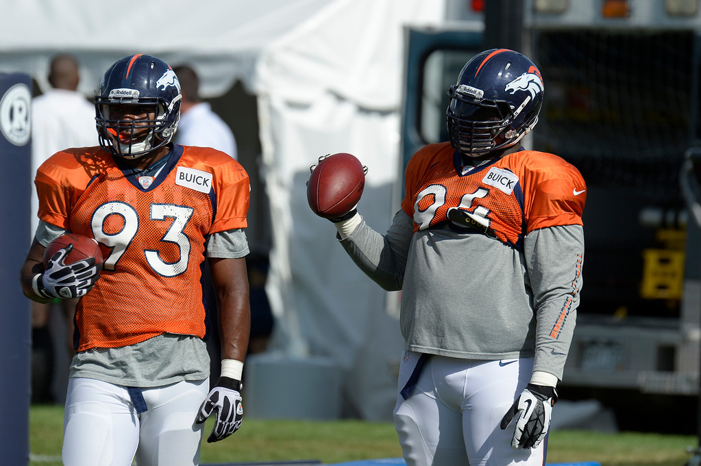 . Denver Broncos DE Jeremy Beal (93) and Terrance Knighton (94) watch drills during training camp August 6, 2013 at Dove Valley. (Photo By John Leyba/The Denver Post)