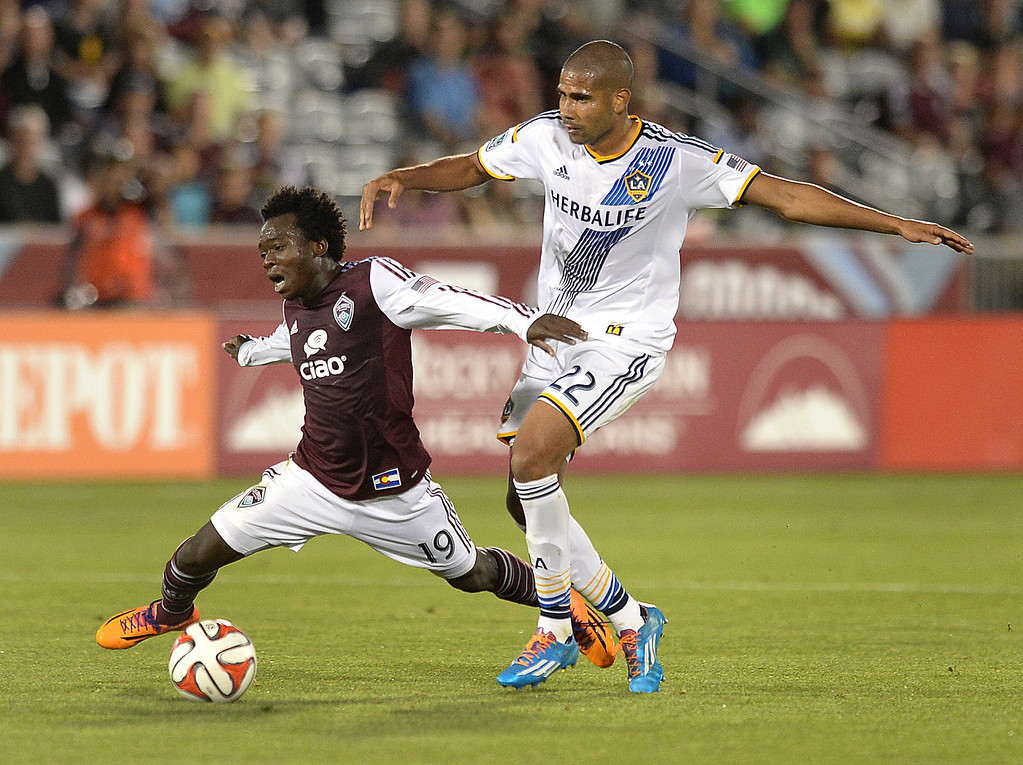 . COMMERCE CITY, CO - MAY 3:  Colorado forward Charles Eloundou (19) and Los Angeles defender Leonardo (22) competed for the ball in the second half. The Colorado Rapids defeated the Los Angeles Galaxy 1-0 Saturday night, May 3, 2014 at Dick\'s Sporting Good Park. (Photo by Karl Gehring/The Denver Post)
