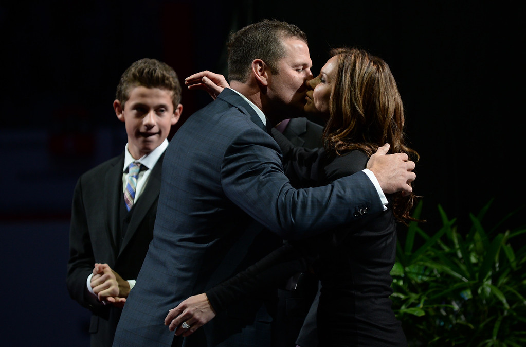 . Adam Foote, former Colorado Avalanche defenseman, kisses his wife Jennifer during the retirement ceremony at Pepsi Center. (Photo by Hyoung Chang/The Denver Post)