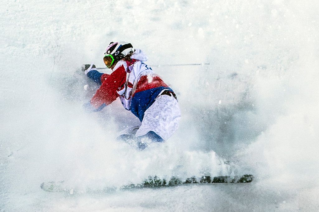 . KRASNAYA POLYANA, RUSSIA  - JANUARY 8: Ekaterina Stolyarova, of Russia, wipes out while competing in the Ladies\' Moguls Finals at Rosa Khutor Extreme Park during the 2014 Sochi Olympic Games Saturday February 8, 2014. Justine Dufour-Lapointe won gold with a score of 22.44. Her sister Chloe Dufour-Lapointe won the silver with a score of 21.66. Hannah Kearney, of USA, won bronze with a score of 21.49. (Photo by Chris Detrick/The Salt Lake Tribune)