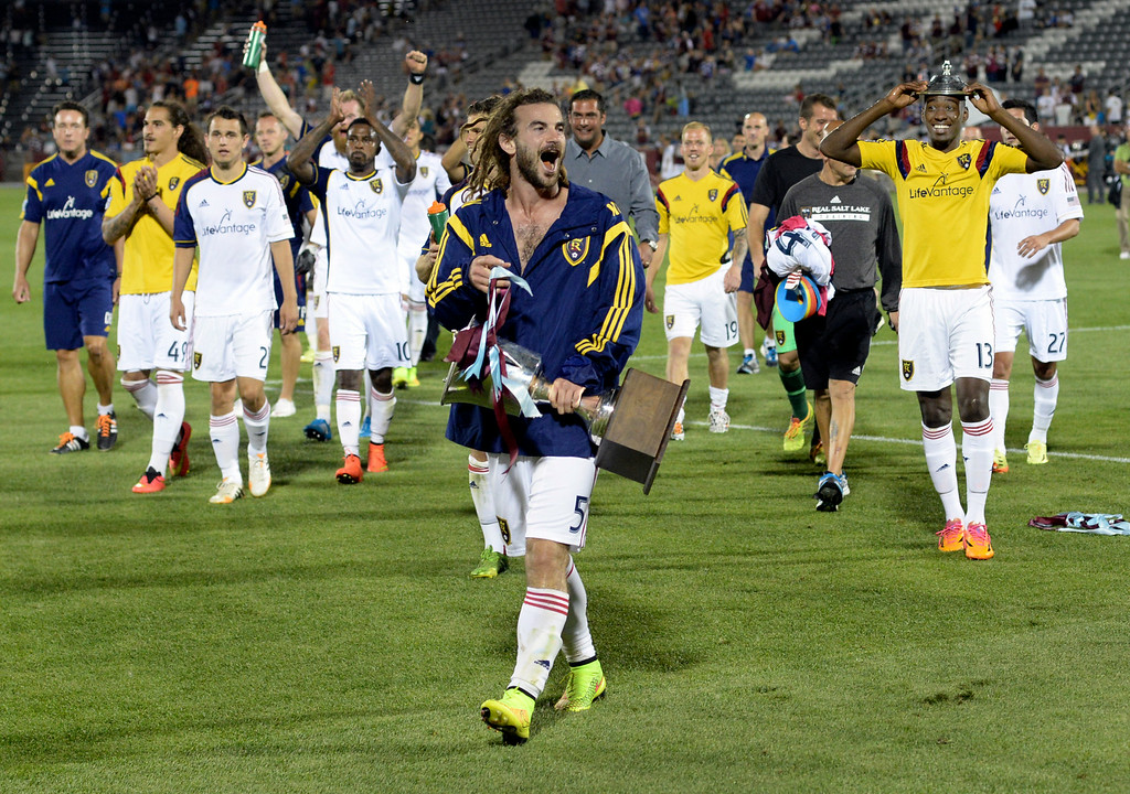 . COMMERCE CITY, CO - AUGUST 2: Salt Lake captain Kyle Beckerman walked off the field carrying the Rocky Mountain Cup Saturday night after the win. Real Salt Lake defeated the Colorado Rapids 1-0 at Dick\'s Sporting Goods Park Saturday night, August 2, 2014.  Photo by Karl Gehring/The Denver Post
