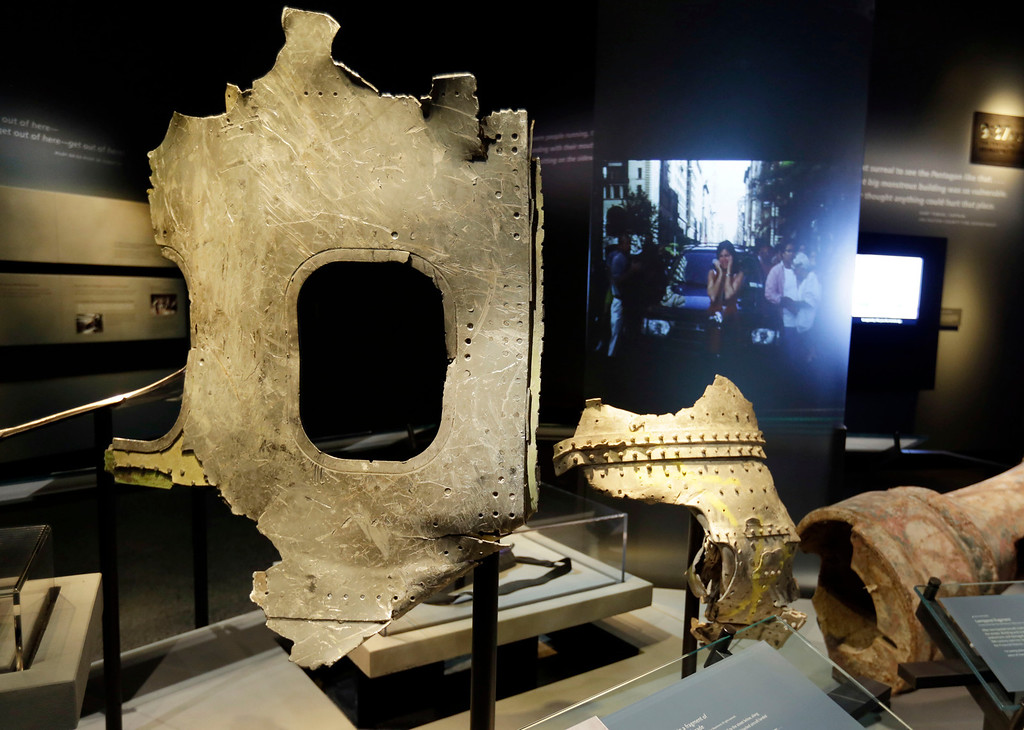 . Fragments of the fuselage of Flight 11, that hit the World Trader Center, are displayed at the National Sept. 11 Memorial Museum, Wednesday, May 14, 2014, in New York.   (AP Photo)