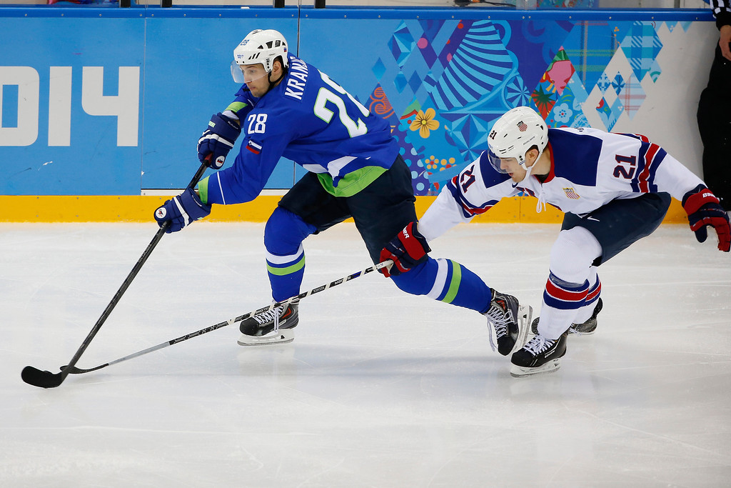 . USA forward James van Riemsdyk races after Slovenia defenseman Ales Kranjc during the 2014 Winter Olympics men\'s ice hockey game at Shayba Arena Sunday, Feb. 16, 2014, in Sochi, Russia. (AP Photo/Petr David Josek)