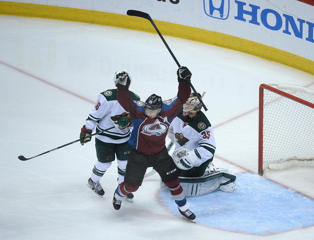 . DENVER, CO - APRIL 24: Colorado\'s Paul Stastny celebrated after center Nathan MacKinnon scored in overtime to give the Avalanche a 4-3 win Saturday night. The Colorado Avalanche hosted the Minnesota Wild in the fifth game of a playoff series Saturday night, April 26, 2014. (Photo by Karl Gehring/The Denver Post)