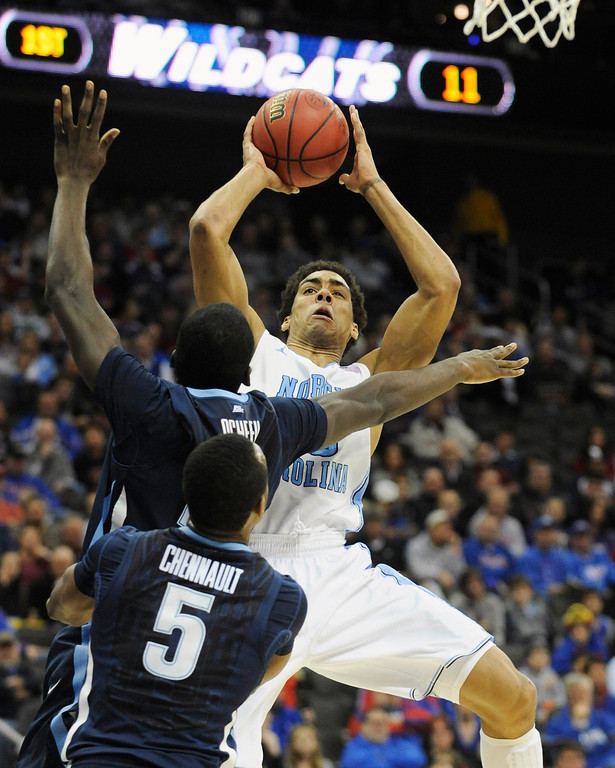 . North Carolina Tar Heels forward James Michael McAdoo shoots against the Villanova Wildcats during the first half of the second round of the NCAA men\'s basketball tournament at the Sprint Center in Kansas City, Missouri, March 22, 2013. REUTERS/Dave Kaup