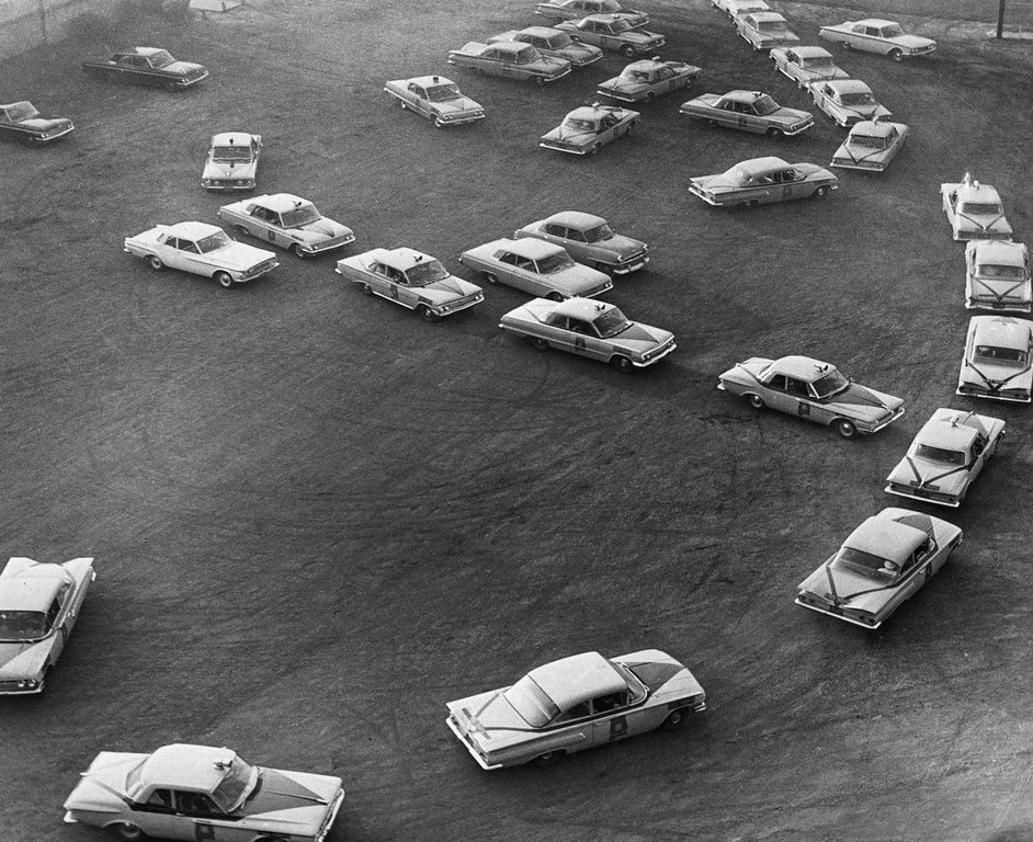. Cars of the Alabama Highway Patrol move out of a parking area in Birmingham, Ala., to take up positions at three schools which Gov. George Wallace has barred to blacks, Sept. 9, 1963. The governor issued an executive order early today opening the schools but on a segregated basis. (AP Photo)