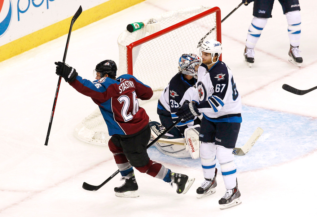 . Colorado Avalanche center Paul Stastny, left, celebrates scoring the go-ahead goal as Winnipeg Jets goalie Al Montoya, back right, and right wing Michael Frolik, right front, of the Czech Republic, react in the third period of the Avalanche\'s 3-2 victory in an NHL hockey game in Denver on Sunday, Oct. 27, 2013. (AP Photo/David Zalubowski)