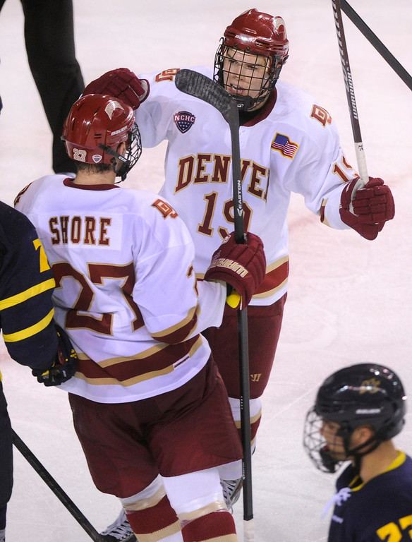 . DENVER, CO. - OCTOBER 12: Denver center Daniel Doremus (19) celebrated his third period goal with wing Quentin Shore. The University of Denver hockey team blanked Merrimack 4-0 at Magness Arena, Saturday night, October 12, 2013. Photo By Karl Gehring/The Denver Post