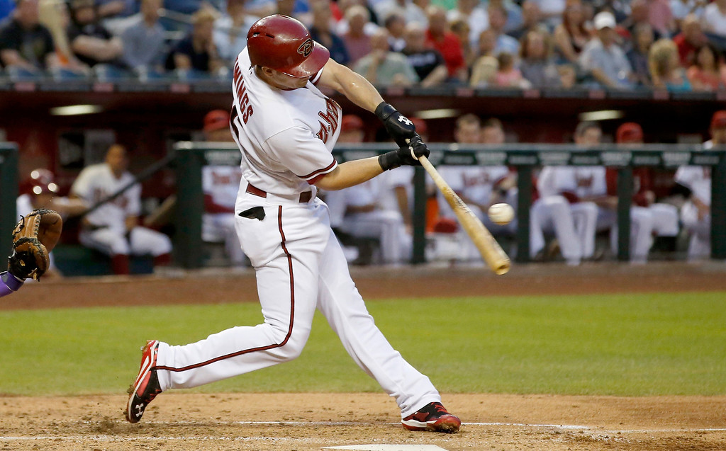 . Arizona Diamondbacks\' Chris Owings connects for an RBI double against the Colorado Rockies during the second inning of a baseball game on Tuesday, April 29, 2014, in Phoenix. (AP Photo/Ross D. Franklin)