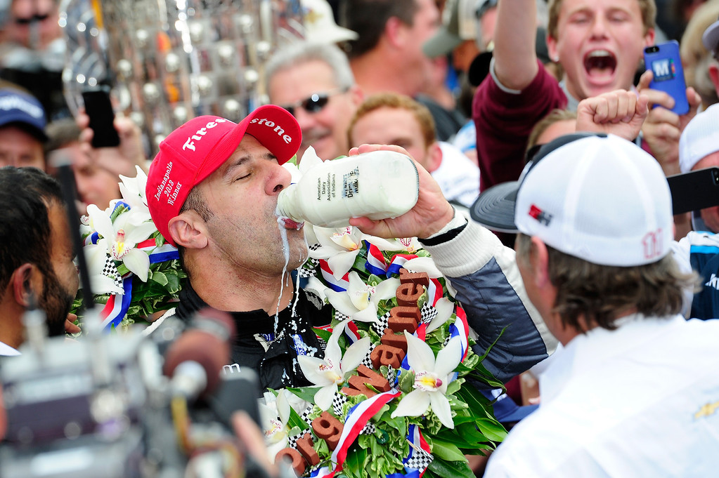 . Tony Kanaan of Brazil, driver of the Hydroxycut KV Racing Technology-SH Racing Chevrolet, takes a sip of milk in victory lane as he celebrates winning the IZOD IndyCar Series 97th running of the Indianpolis 500 mile race at the Indianapolis Motor Speedway on May 26, 2013 in Indianapolis, Indiana.  (Photo by Robert Laberge/Getty Images)