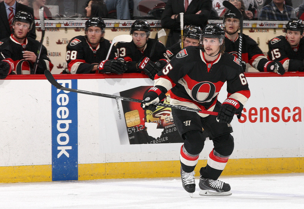 . Erik Karlsson #65 of the Ottawa Senators skates against the Colorado Avalanche in his 300th career NHL game during an NHL game at Canadian Tire Centre on March 16, 2014 in Ottawa, Ontario, Canada.  (Photo by Jana Chytilova/Freestyle Photography/Getty Images)