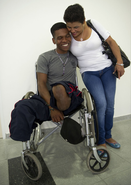. Colombian soldier Aldemar Benitez (L), 23,  hugs his mother Rosa Castano after  the rehabilitation therapy session.  RAUL ARBOLEDA/AFP/Getty Images