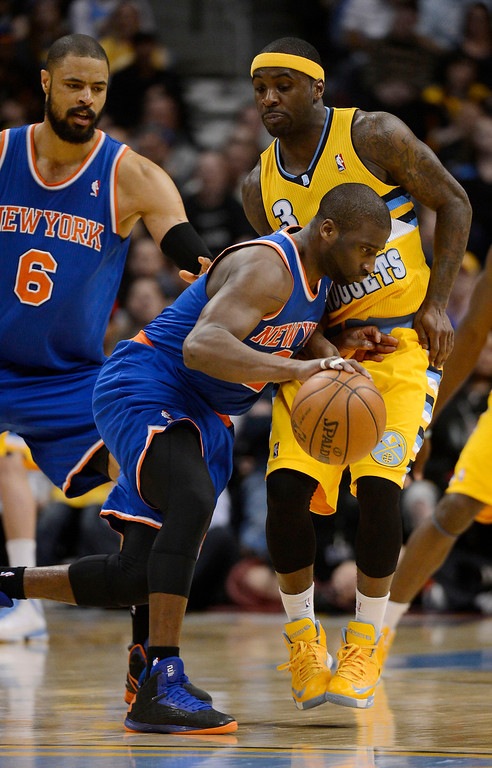. Raymond Felton (2) of the New York Knicks drives on Ty Lawson (3) of the Denver Nuggets during the second quarter March 13,  2013 at Pepsi Center. (Photo By John Leyba/The Denver Post)