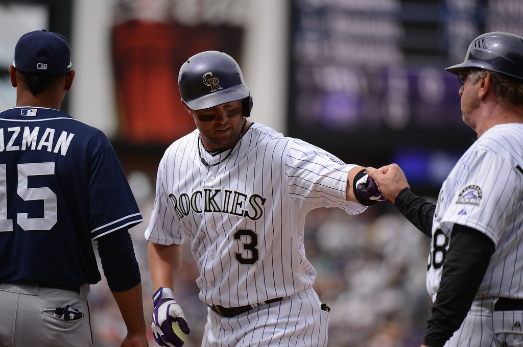 . Michael Cuddyer (3) of the Colorado Rockies reaches first after hitting a single to left center in the second inning. (Photo by Hyoung Chang/The Denver Post)