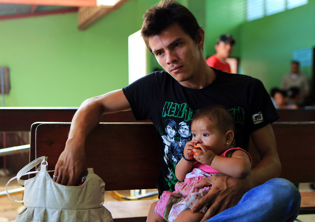 . A man waits for his daughter to the treated for dengue fever, at the Cristo del Rosario health centre in Managua, on October 25, 2013. The Nicaraguan government issued a health red alert as a dengue fever epidemic has killed 13 people so far this year - six in the past week - and infected more than 4,000 individuals, according to presidential spokesman Rosario Murillo. Dengue, transmitted by the Aedes aegypti mosquito, occurs in Central America mostly during its rainy season from May to November. The disease causes fever, muscle and joint ache as well as potentially fatal dengue hemorrhagic fever and dengue shock syndrome. Inti Ocon/AFP/Getty Images