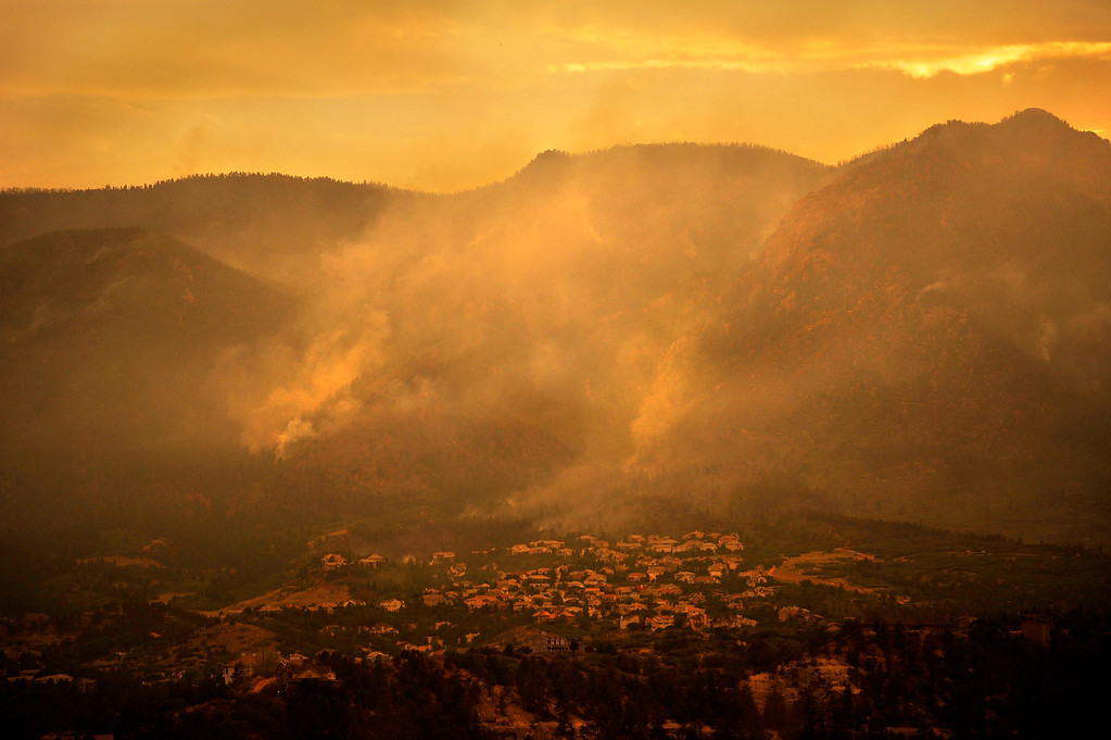 . As the sun sets, the Waldo Canyon Fire continues to grow, Wednesday, June 27, 2012, near Colorado Springs, Colo.