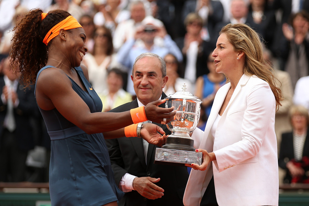 . Serena Williams of United States of America receives the Coupe Suzanne Lenglen from Arantxa Sanchez Vicario after victory in the Women\'s Singles Final match against Maria Sharapova of Russia  during day fourteen of French Open at Roland Garros on June 8, 2013 in Paris, France.  (Photo by Matthew Stockman/Getty Images)