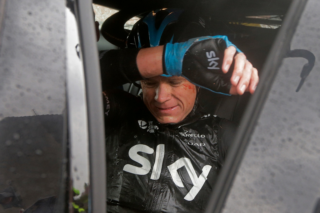 . Britain\'s Christopher Froome gets into his team car as he abandons the race following a third consecutive crash in two days during the fifth stage of the Tour de France cycling race over 155 kilometers (96.3 miles) with start in Ypres, Belgium, and finish in Arenberg, France, Wednesday, July 9, 2014. (AP Photo/Laurent Cipriani)