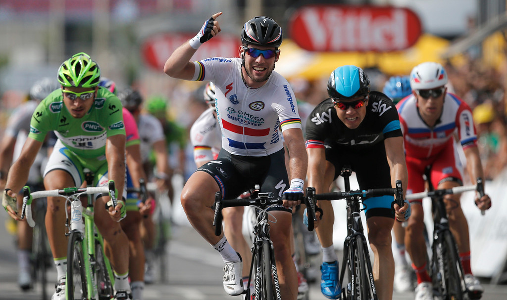 . Britain\'s Marc Cavendish crosses the finish line ahead of Edvald Boasson Hagen of Norway, second place, second right, and Peter Sagan of Slovakia, third place, left, to win the fifth stage of the Tour de France cycling race over 228.5 kilometers (142.8 miles) with start in Cagnes-sur-Mer and finish in Marseille, southern France, Wednesday July 3, 2013.  (AP Photo/Christophe Ena)