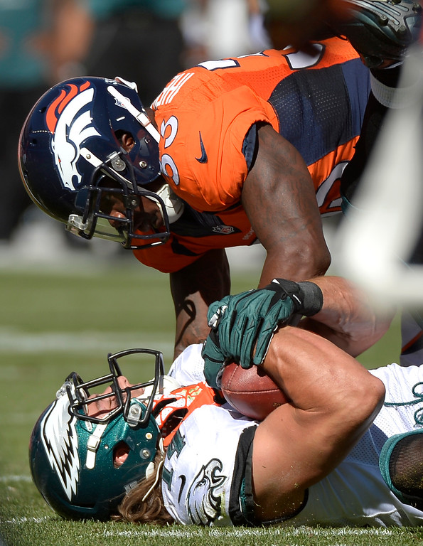. Denver Broncos strong safety Duke Ihenacho (33) tackles Philadelphia Eagles wide receiver Riley Cooper (14) during the second quarter. (Photo by Joe Amon/The Denver Post)