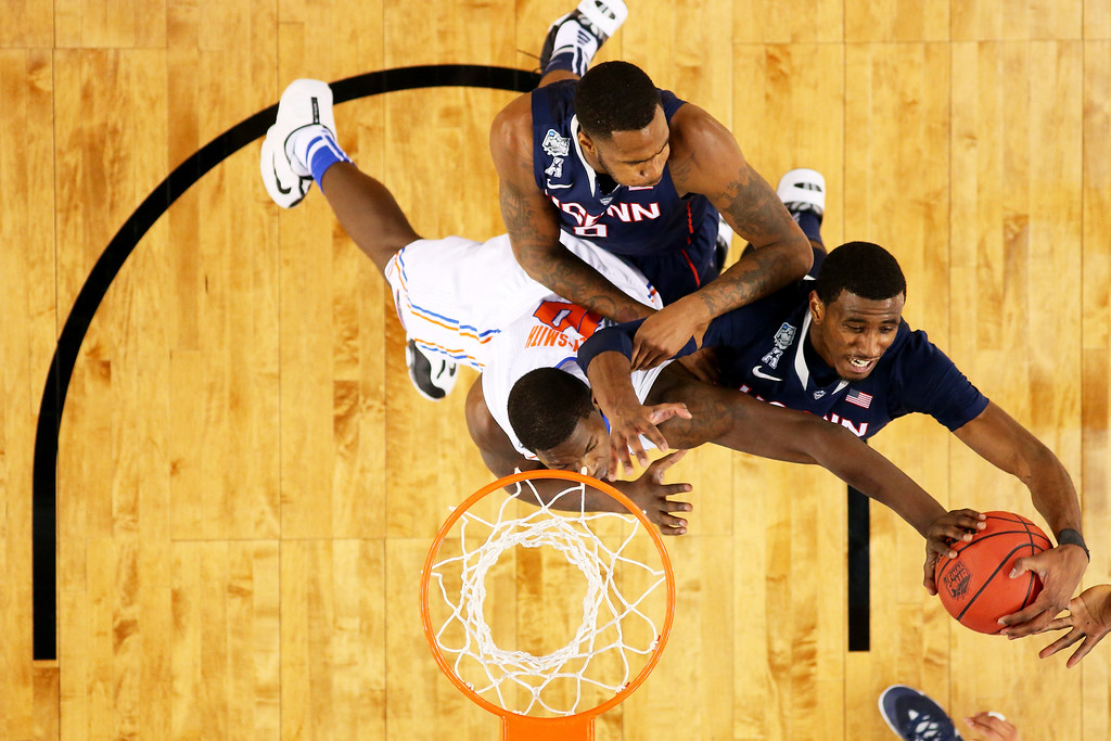 . ARLINGTON, TX - APRIL 05: DeAndre Daniels #2 of the Connecticut Huskies battles for a rebound against Dorian Finney-Smith #10 of the Florida Gators during the NCAA Men\'s Final Four Semifinal at AT&T Stadium on April 5, 2014 in Arlington, Texas.  (Photo by Ronald Martinez/Getty Images)