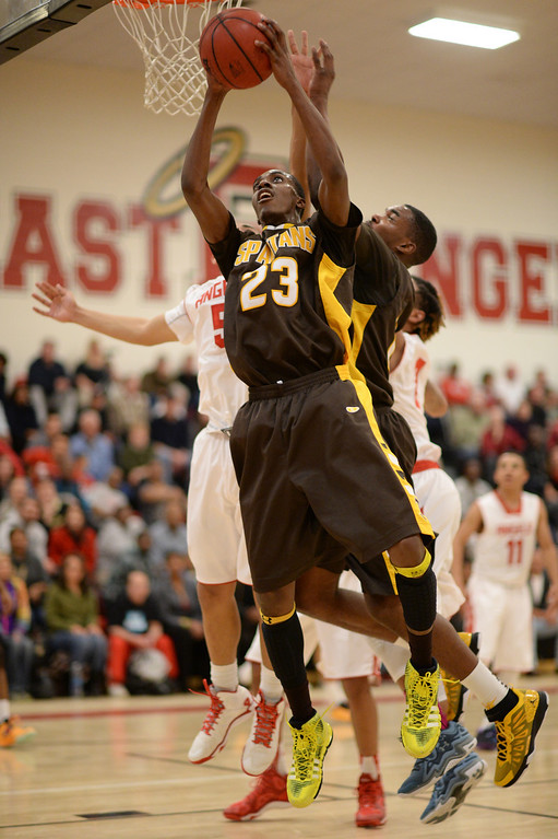 . DENVER, CO. JANUARY 24: Josh McNair of Thomas Jefferson High School (23) controls the rebound during the 1st half of the game at East High School in Denver, Colorado January 24, 2014. East High School won 91-62. (Photo by Hyoung Chang/The Denver Post)