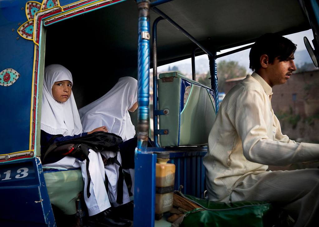 . Pakistani girls get a ride in a Ricksha on their way to school in Mingora, Swat Valley, Pakistan on Oct. 5, 2013. A year ago a Pakistani girl Malala Yousufzai was shot in the head by Taliban as she was leaving school with others in a small pick-up truck used to transport children. (AP Photo/Anja Niedringhaus)